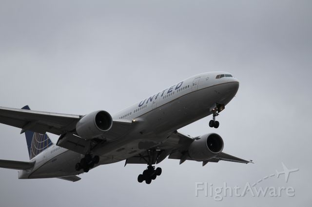 Boeing 777-200 (N783UA) - UAL896 landing on 28C from Hong Kong.