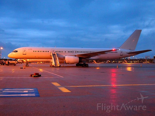 Boeing 757-200 (G-POWH) - Small 25 Years Titan on the left side of the door