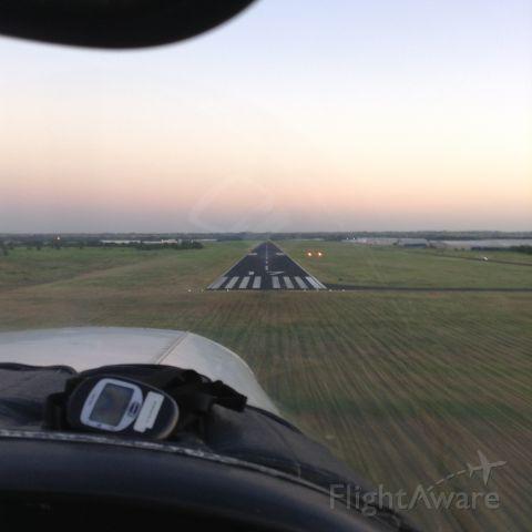 Piper Cherokee (N8252N) - short final rwy 17, safety pilot on RNAV practice approach.