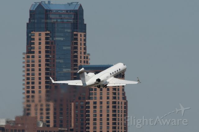 Dassault Falcon 2000 (N2CC) - The Carlson Companies Gulfstream IV    Departing from runway 32.  Downtown St. Paul is in the background