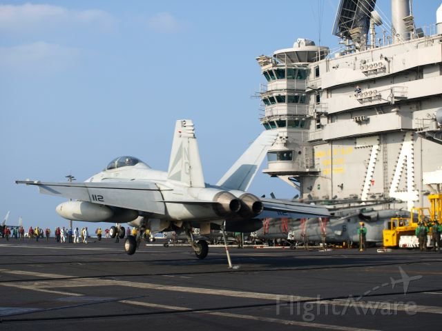 — — - F/A-18F Super Hornet of VFA-154 landing on USS JOHN C. STENNIS during the 2009 deployment as viewd from the LSO platform.