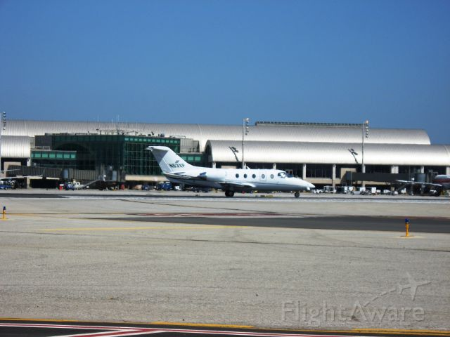 Beechcraft Beechjet (N63XP) - Line up and wait on RWY 19R