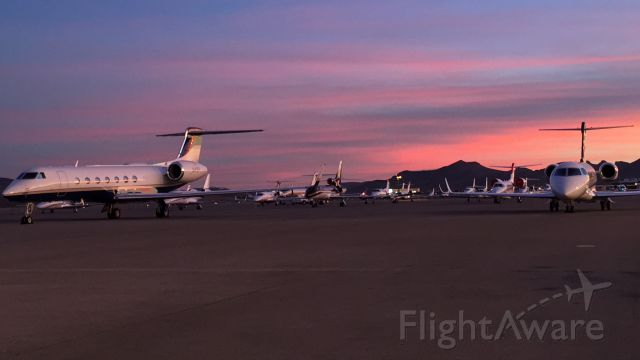 — — - Sunset at KHND during NBAA2015