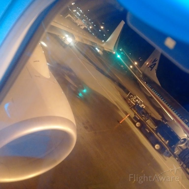 Boeing 737-800 — - Deicing the wings.
