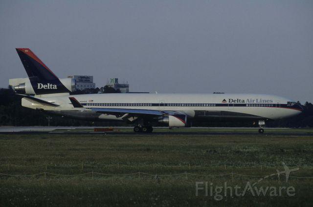 Boeing MD-11 (N804DE) - Departure at Narita Intl Airport Rwy16R on 1998/07/18