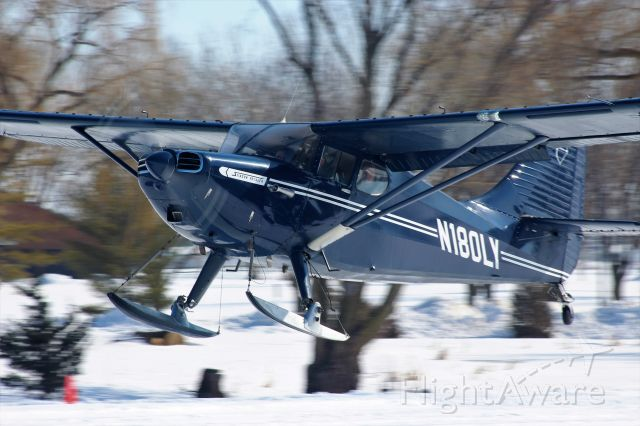 Piper 108 Voyager (N180LY) - A handsome Piper Stinson Voyager making its way in to the EAA Oshkosh Ski Plane Fly-In 2020.