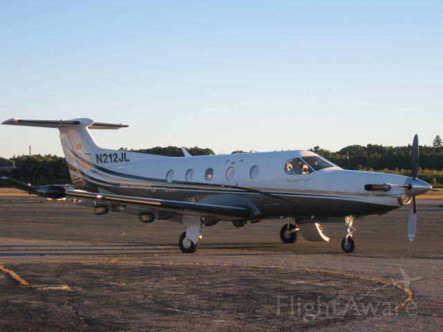 Pilatus PC-12 (N212JL) - Sitting on the ramp after arriving from Farmingdale, NY (KFRG). Getting ready to depart to Caldwell, NJ (KCDW).