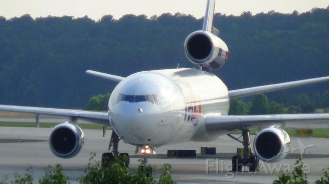 McDonnell Douglas DC-10 (N385FE) - FedEx 765 arriving from Memphis at 6;56 P.M.   Taken June 7, 2015.
