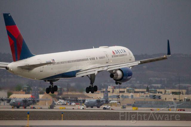 Boeing 757-200 (N669DN) - Delta B757 landing RWY 34R at Reno-Tahoe International just ahead of rain showers.