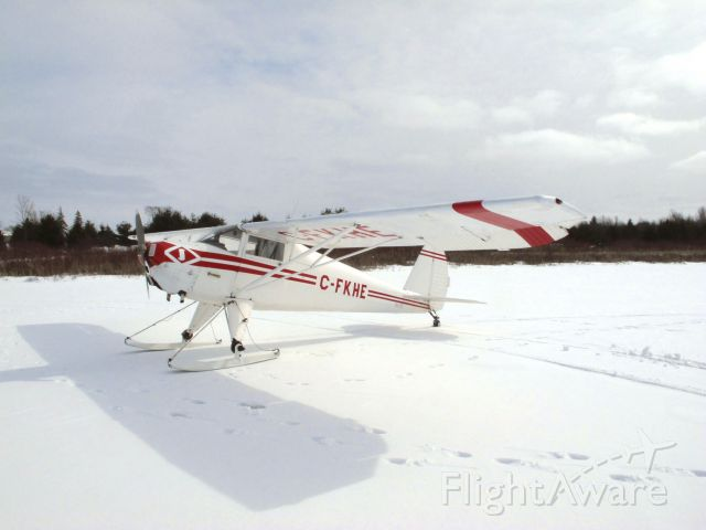 TEMCO Silvaire (C-FKHE) - Luscombe 8C sitting pretty on skis for a fly-in on a frozen Camden Lake, near Yarker, Ontario, Canada on March 3rd, 2013