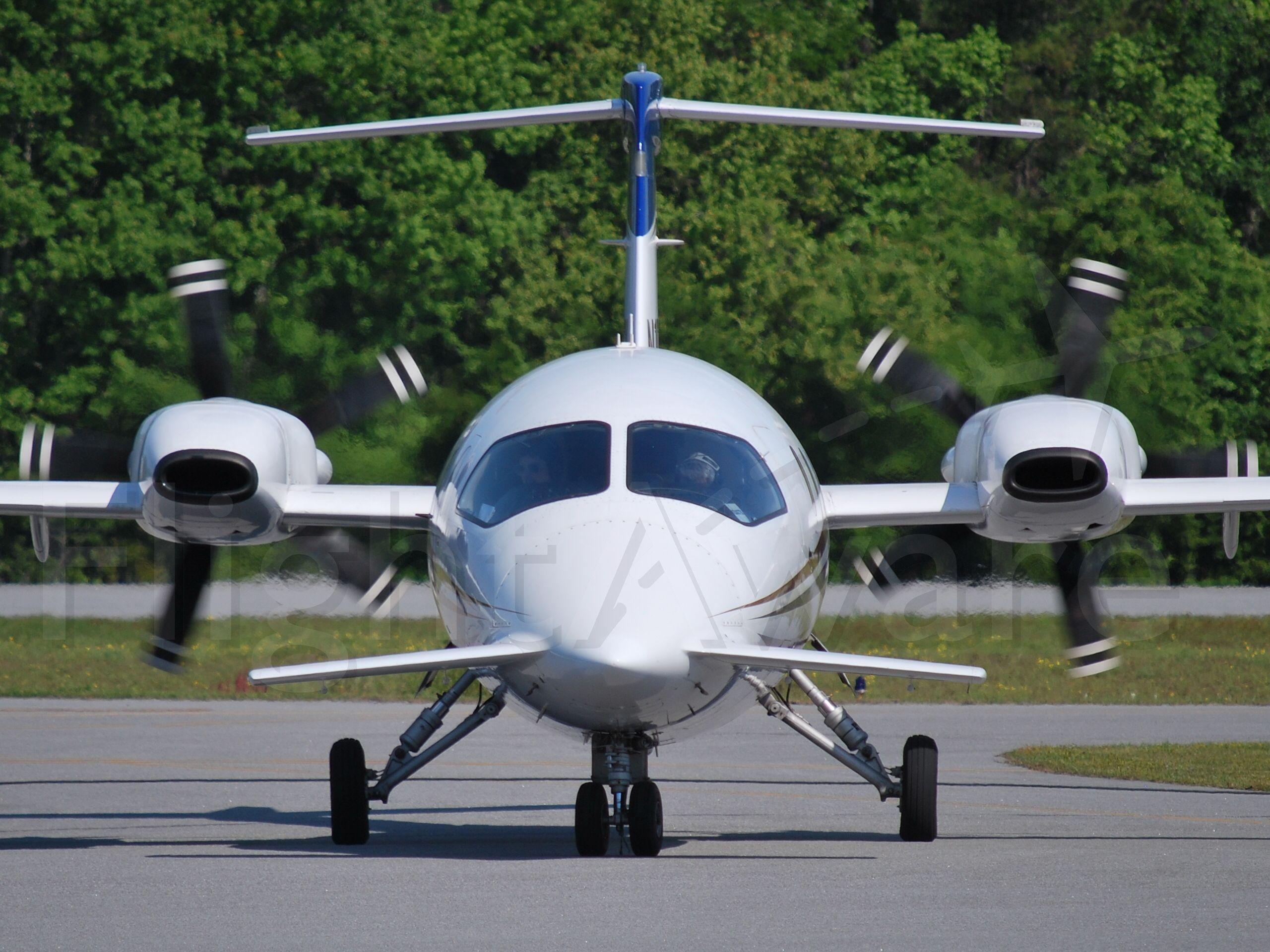 Piaggio P.180 Avanti (N102SL) - AGI HOLDINGS CORP taxiing in from runway 03 - 4/24/09