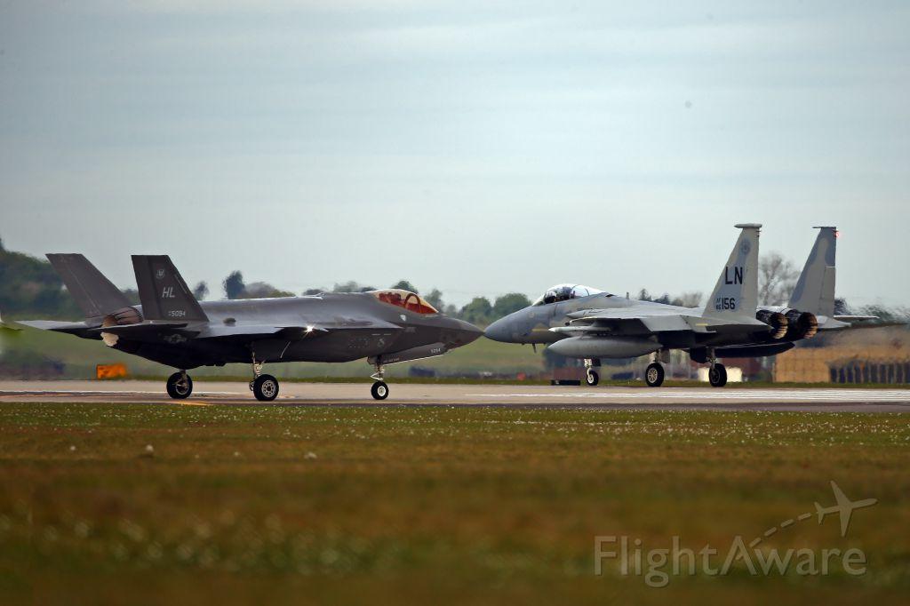 Lockheed F-35C (14-5904) - Present and future.  F-35A on deployment to Lakenheath, Suffolk, UK, holding short as F-15C starts its takeoff run.