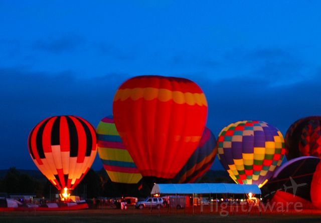 """Unknown/Generic Balloon — - Sussex, New Brunswick Sept 7 2012. Annual Balloon Festival """"Moon Glow"""" event.  After dusk, brief blasts of flame light them up from inside."""