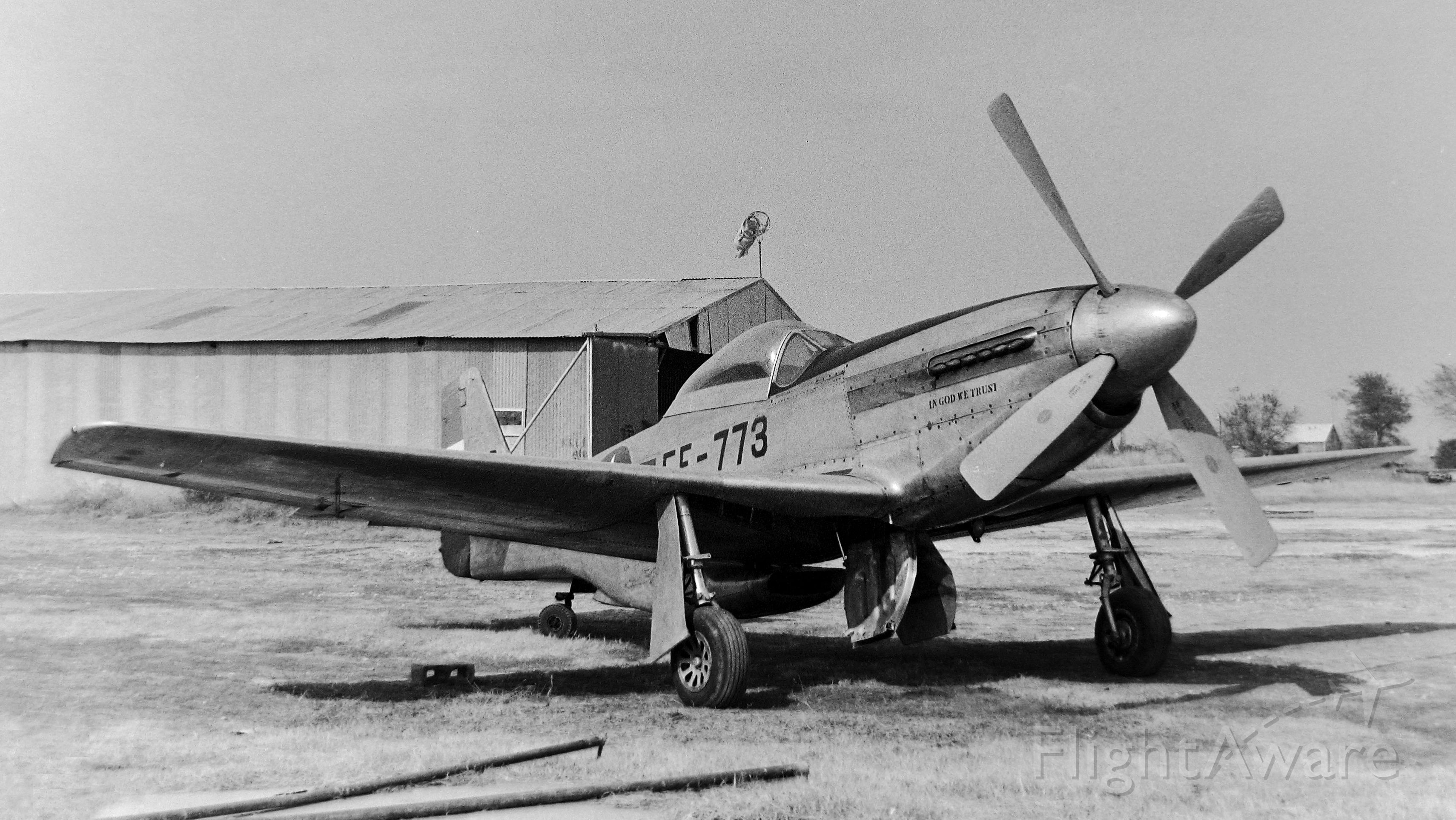 """North American P-51 Mustang — - Taken at the old Flying Tiger Field at Toco, Texas in 1973. I thought at one time I had some info on """"In God We Trust"""" but can't find anything about it now."""