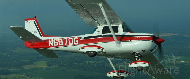 Cessna Commuter (N6970G) - This C150 belonged to a senior Delta Captain. Photo was shot on the way to the annual C150/152 summer get together.br /Photo by Glen Coombe