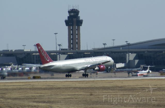 — — - Omni Air taking off from KDFW.