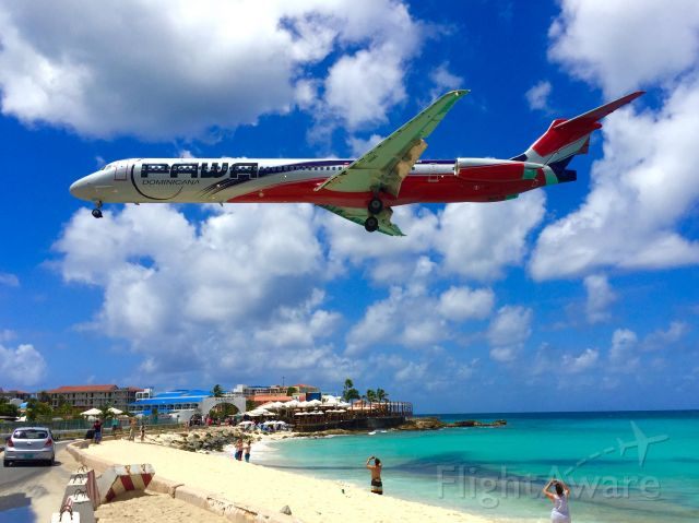 McDonnell Douglas MD-83 (HI990) - Classic Maddog posing for early morning beach goers over everfamous Maho Beach, St. Maarten.
