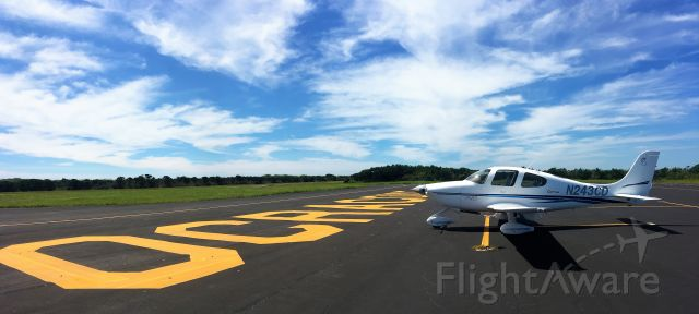 Cirrus SR-20 (N243CD) - On the ramp at Ocracoke. Walking distance from many $100 hamburger sites!