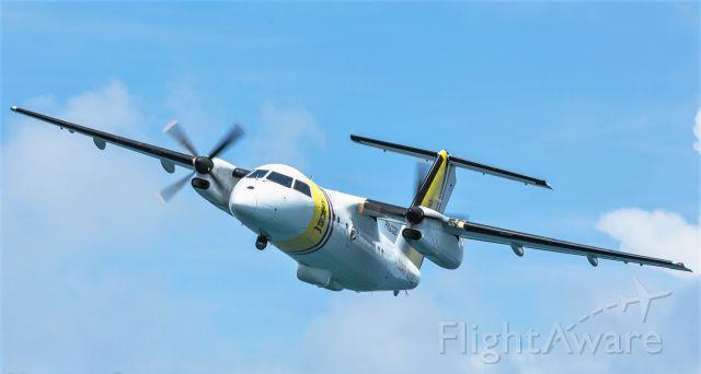 de Havilland Dash 8-100 (PH-CGB) - Coast Guard de Havilland Dash 8-100 (PH-CGB) out on patrol over the Caribbean sea.
