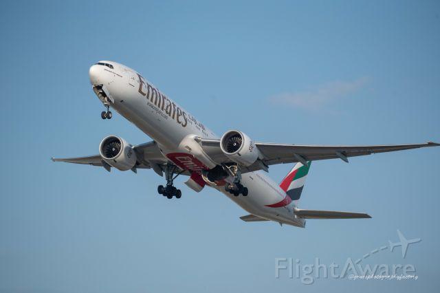 Boeing 777-200 (A6-EOB) - Beautiful B777 departing Miami International Airport.