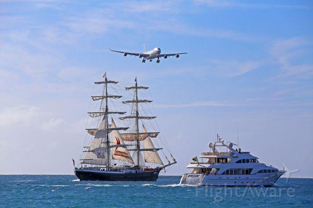Airbus A340-300 (F-GLZU) - From Maho Beach. Spotting location on the boats...