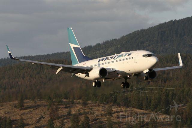 Boeing 737-700 (C-GUWJ) - August 12, 2009 - evening arrival at Kelowna, British Columbia