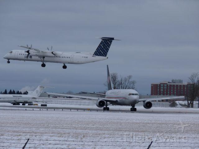 C-GLQE — - landing on #32 while cargojet 767 waits it