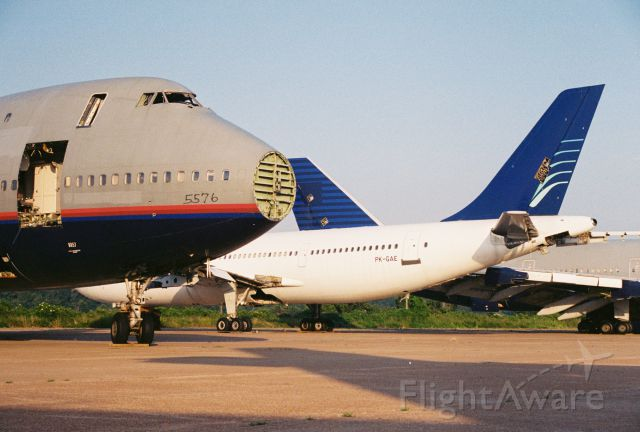 BOEING 747-100 — - Business was booming... photo at Greenwood-Leflore Airport, KGWO, from circa 2000 of yet another United Airlines 747 headed for the breaker. The hapless Boeing had lots of company on the ramp.