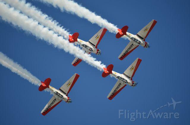 North American T-6 Texan — - EAA 2011 Aeroshell Team performing.