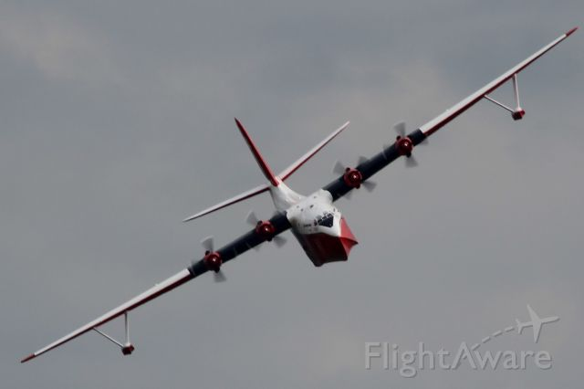 MARTIN Mars (C-FLYL) - A little blurry.....but such a nice bank for such a big aircraft.