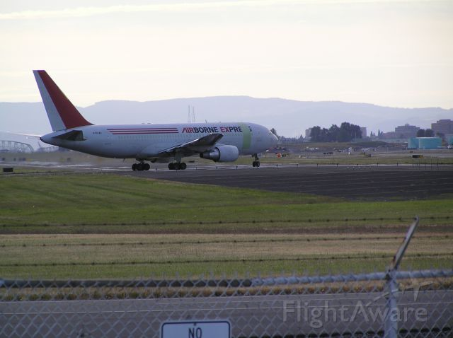BOEING 767-200 (N793AX) - Approach end of 28L, sundown, August 21, 2010. Unusual paint scheme version.