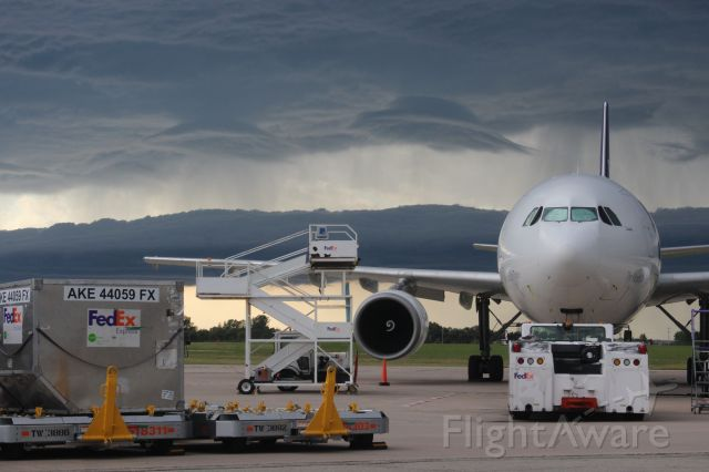 Airbus A300F4-600 (N676FE) - Storm clouds approaching at the dinner hour.......flying saucer shaped lenticular clouds.