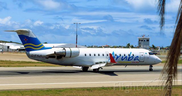 Canadair Regional Jet CRJ-200 (C-FXLH) - Air Aruba Landing at TNCM St Maarten.
