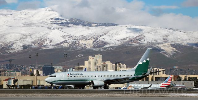 Boeing 737-800 (N916NN) - AAL's Reno Air heritage livery special schemebird (N916NN) is down and slowing as it passes in front of the downtown Reno city skyline after landing on runway 16R to complete a DFW-RNO trip.