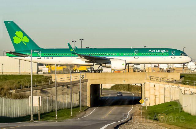 Boeing 757-200 (EI-LBR) - Aer Lingus 757-200WL bridge crossing for evening arrival at Toronto YYZ