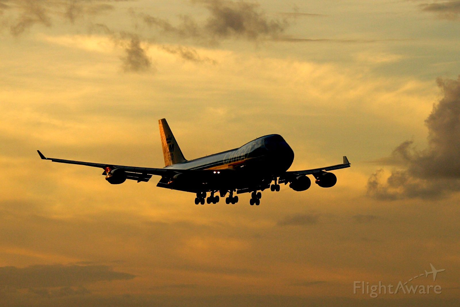 """Boeing 747-400 (PH-CKC) - Check out our aviation videos with 100% authentic and non-leveled sound! <a rel=""""nofollow"""" href=""""http://youtube.com/ilikerio"""">https://youtube.com/ilikerio</a><br /><br />""""Oranje / Orange"""" on short final to 9 at sunset, operated by Martinair Cargo."""