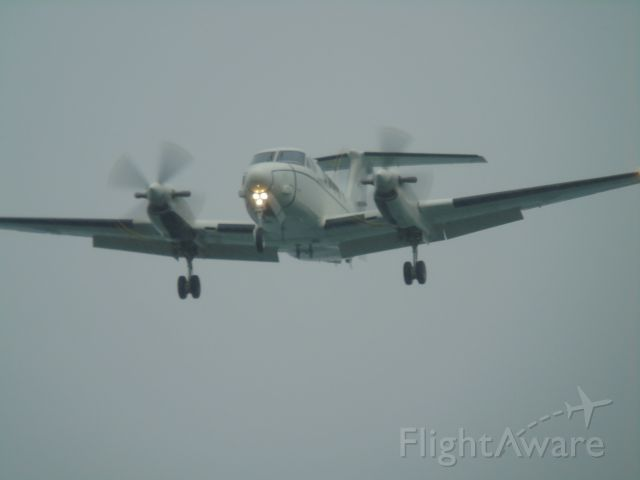 8400162 — - A few seconds till touchdown at around 5:45pm on Monday the 20th in heavy rain. On approach over the pacific ocean to NAS Whidbey Island. Aircraft is a Beechcraft UC-12 Huron, anyone know an icao code?