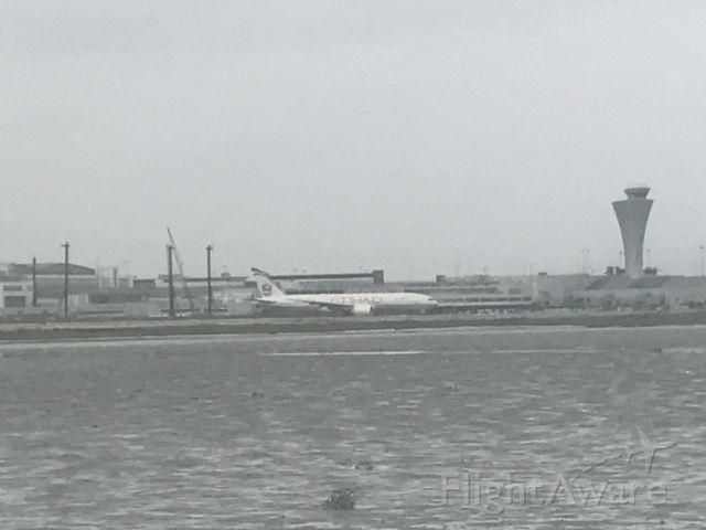 BOEING 777-200LR — - Etihad Airways B777-200lr taxiing for takeoff at SFO.