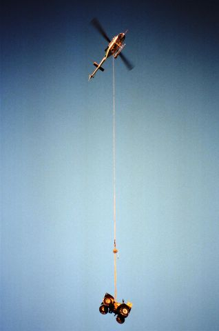 — — - Helicopter Delivering A.T.V . Northern Alberta, Canada. 1999.