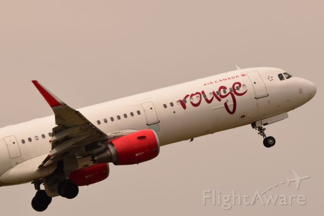 Airbus A321 (C-FJQL) - Air Canada Rouge A321 departing Regina for Toronto