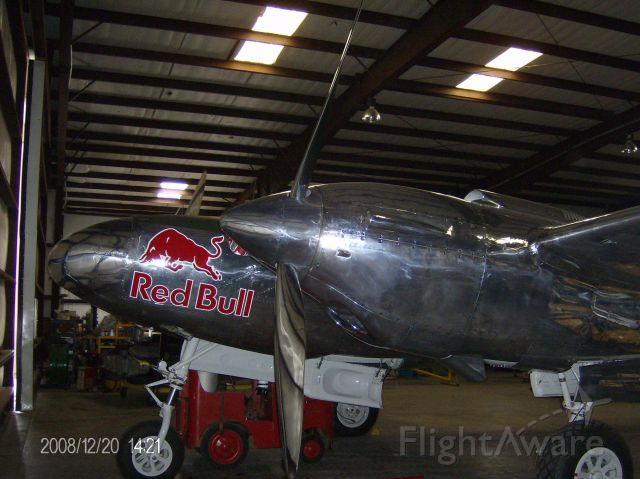 """N25Y — -      After full restoration of 80,000 manhours and nearly four years at KBKD, Flying Bull P-38 is now based in the """"glass hangar"""" at Mozart Airport (SZG), Salzburg, Austria. N25Y has flown numerous demos at airshows around Europe... Visit the glass hangar (Hangar 7) at LOWS if you can.br /    Whether you want to see N25Y when Lefty Gardner flew White Lightnin or watch N25Y fly over the Danube River in Budapest, please see my PlayList for the best of the P-38 videos. Enjoy: a rel=nofollow href=http://www.youtube.com/playlist?list=PL6CAAFD779081913Fhttps://www.youtube.com/playlist?list=PL6CAAFD779081913F/a"""