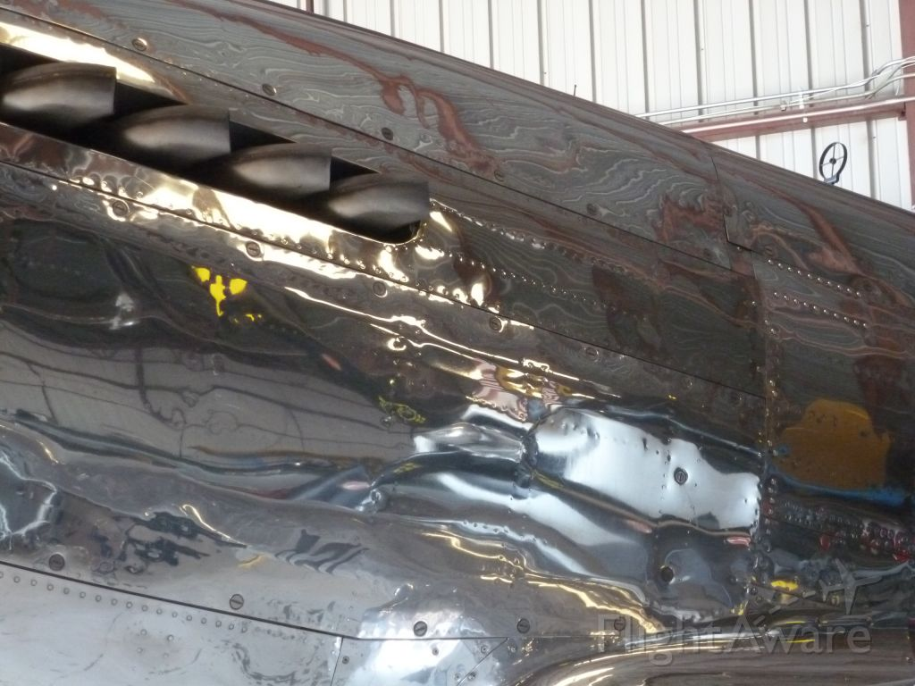 — — - Reflection off P-51a at Planes of Fame Museum, Chino, CA