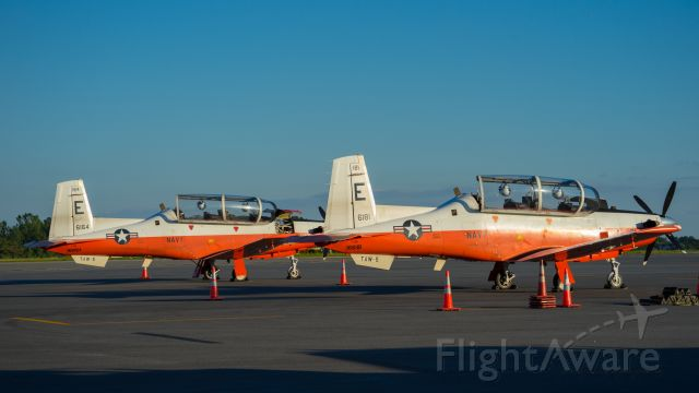N6181 — - These Taw-5 training aircraft arrived recently at PDK airport, for a rest stop and refueling.<br />The one on the right landed first, with the one on the left following behind a few minutes later.  The sun is setting, thus giving them an evening glow.