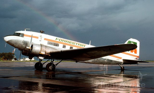 Douglas DC-3 (VH-TAK) - Beautiful wet day photo of ex TAA DC-3 at Essendon 10/1976 taken by the late Mike Madden and now part of the Tony Arbon collec tion