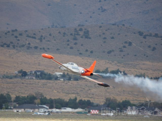 — — - Smoke On! Planes of Fame Canadair CT-133 turns show smoke on to lead unlimited planes to starting line at the Reno Air Races 2018.