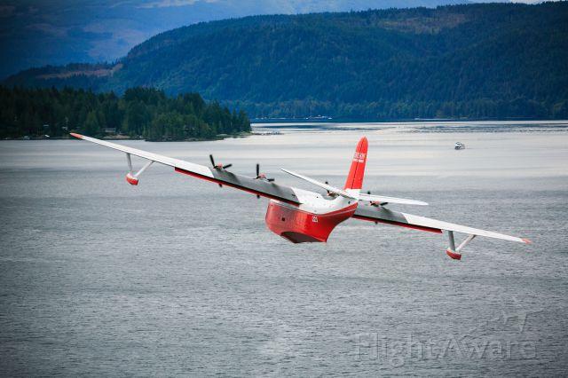 C-FLYL — - JRM Martin Mars photo credited to Heath Moffatt