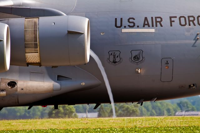 Boeing Globemaster III — - Vapor cone from engine during reverse thrust