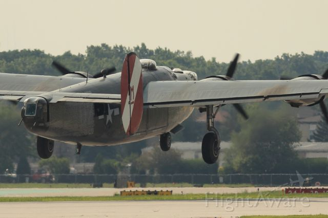 Consolidated B-24 Liberator (N224J) - This B-24 departs runway 16 at Chicago Executive.  It's sister ship, a b-17, was also gracing the skies over the Chicago suburbs.