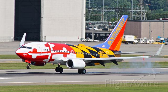Boeing 737-700 (N214WN) - Maryland One touches down on runway 30L with a slight crosswind.