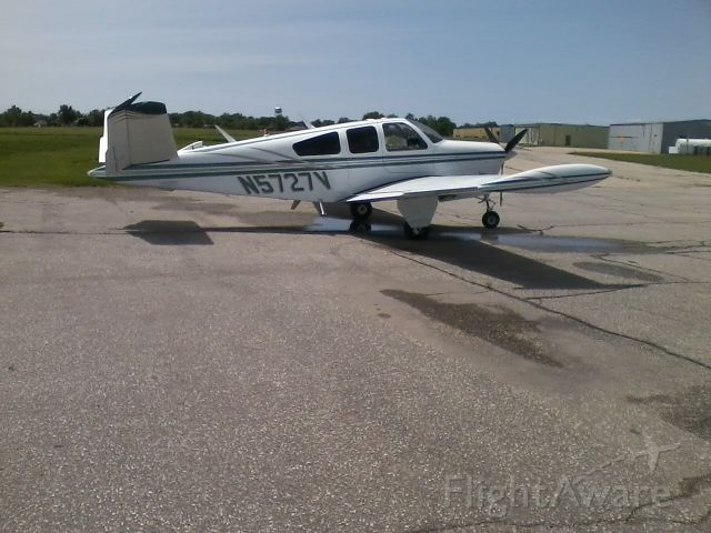 Beechcraft 35 Bonanza (N5727V) - On the ramp with new colors.